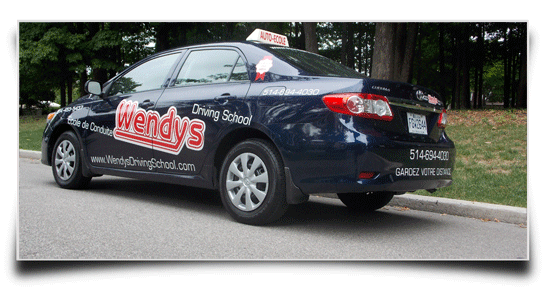 Wendys Driving School - parked along the road