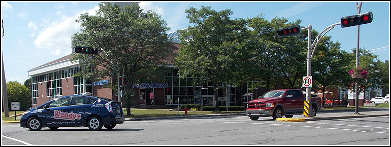 École de Conduite Wendys Driving School Toyota Prius turning at Kirkland QC office width=